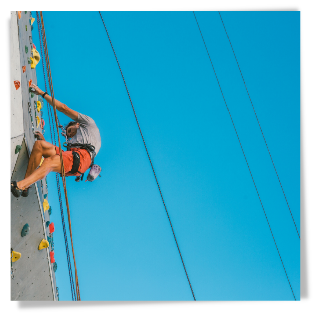 Picture of a man climbing The Big Wall at Basecamp