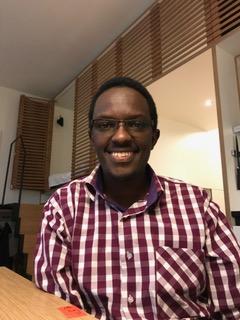 Dr. Elijah Mwaura